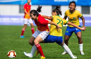 10-woman Chinese soccer team sees off Brazil 2-1 in overtime, into military games final