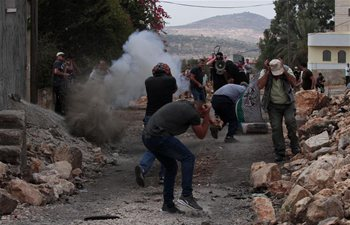 Palestinian protesters clash with Israeli soldiers near West Bank city of Nablus