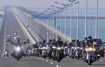 Motorcyclists ride on Sheikh Jaber Al-Ahmad Al-Sabah Causeway in Kuwait City