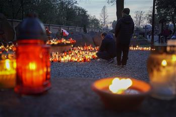 People mourn for deceased on All Saints Day in Poland