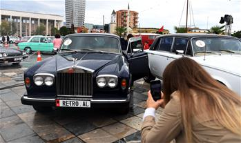 Visitors attend classic vehicle show in Tirana, Albania
