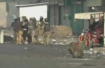 Iraq police, medics: 4 killed, 52 wounded in clashes