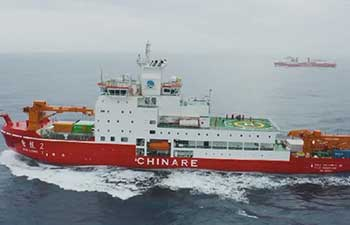 China's first homegrown polar icebreaker passes by iceberg