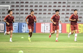 Players of China and Syria attend training sessions before group A match