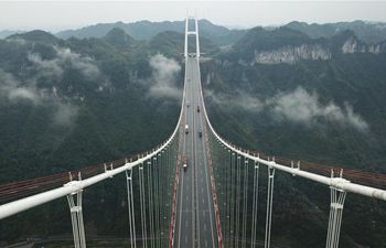 In pics: Aizhai suspension bridge in C China's Hunan