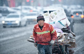 Sanitary workers and vehicles dispatched to clear snow in China's Changchun