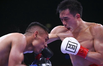 Chinese boxer Xu Can defends WBA featherweight title