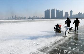 Ice digging festival held in Harbin, China's Heilongjiang