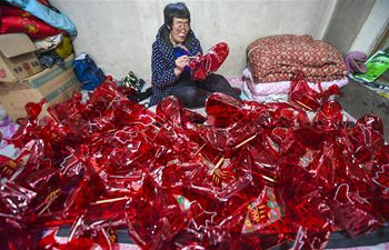 Villagers of Houyi Township make lnterns as Chinese New Year draws near