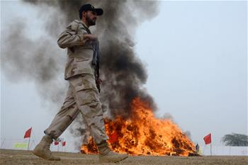 Pakistani anti-narcotics force destroys seized drugs and illegal liquor