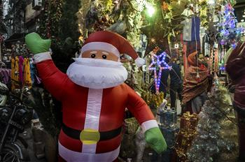 People buy Christmas decorations at market in Kolkata, India