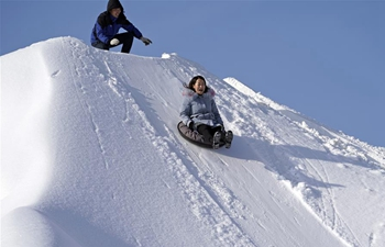 Tourists have fun at ski resort in Jilin