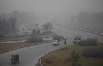 Dense fog blankets NW Pakistan's Peshawar