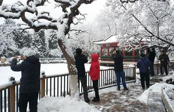 People visit Xuanwuyiyuan Garden after snow in Beijing
