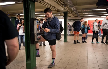 People take part in annual No Pants Subway Ride event in New York