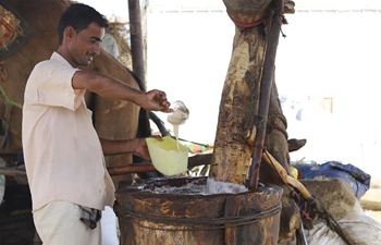 Sesame oil sellers work at oil mill in Hajjah Province, Yemen