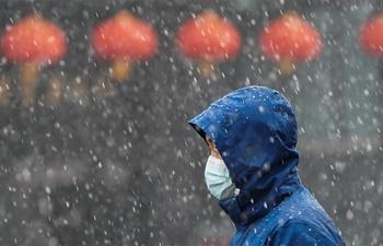 Wuhan witnesses snowfall