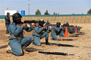 Afghan policemen take part in military training in Daman