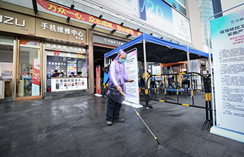 Outdoor tents set up to help tenants resume business in commercial area in Shenzhen