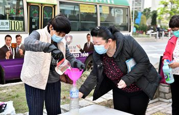 Local residents get free disinfectant distributed by Hong Kong Federation of Trade Unions