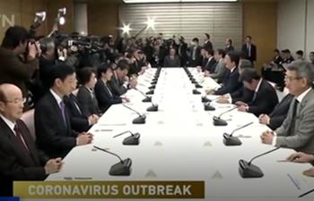 Japan: Dozens allowed off cruise ship show symptoms despite previous negative test results