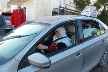 Palestinian elderly woman learns to drive in West Bank City of Hebron