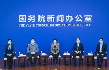Experts attend video press conference in Wuhan