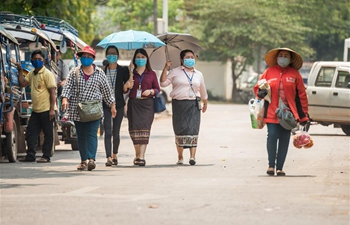 Lao people take preventive measures against COVID-19