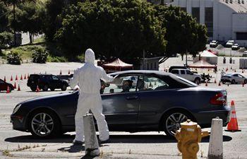 In pics: drive-thru coronavirus test site in Los Angeles