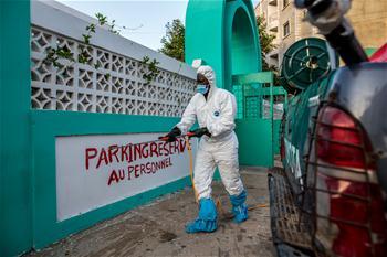 Health workers disinfect in Dakar, Senegal