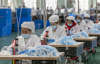Mask production gets into high gear in company in Shanghai