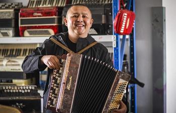 Pic story of accordion repairer in Tacheng, Xinjiang