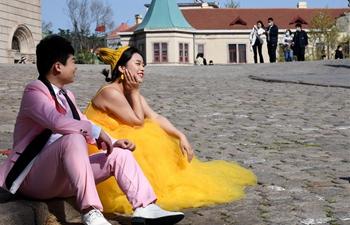Couples take wedding photos in Qingdao, Shandong