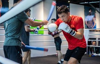 WBA featherweight world champion Xu Can of China attends training session