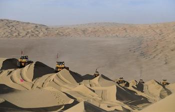 Construction of highway running through Taklimakan Desert enters final rush in NW China's Xinjiang