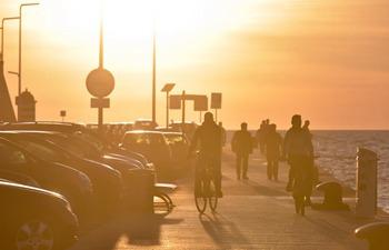 People enjoy sunset by Adriatic Sea in Zadar