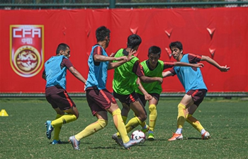 Players of China U16 men's football team train for AFC U16 Championship in Haikou