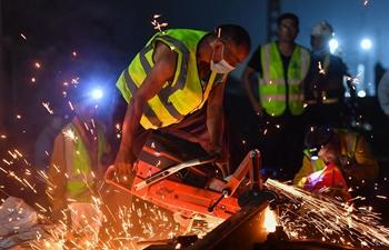 Railway builders work overnight for railway upgrades in Guangzhou