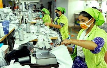 Workers work at garment factory in Dhaka, Bangladesh