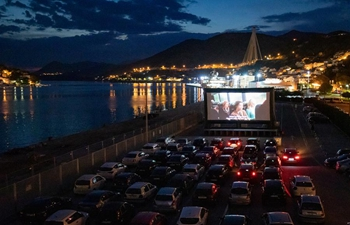 People watch movie at drive-in cinema at Port of Gruz in Croatia