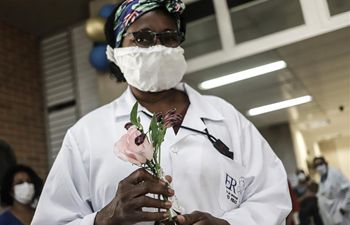 Medics fighting against COVID-19 in Sao Paulo receive flowers