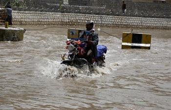 In pics: flooded street following heavy rains in Sanaa, Yemen