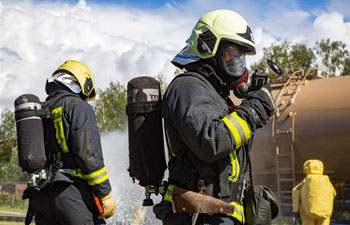 Firefighters participate in drill to cope with ecological disaster in Riga, Latvia