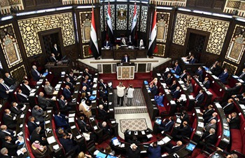 Syrian lawmakers attend swearing-in ceremony in Damascus