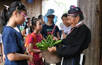 89-year-old She ethnic group woman promotes village's tourism