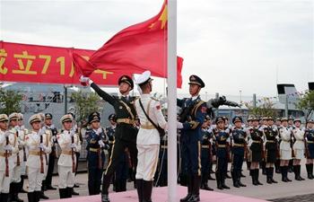 Hong Kong raises flags to celebrate National Day