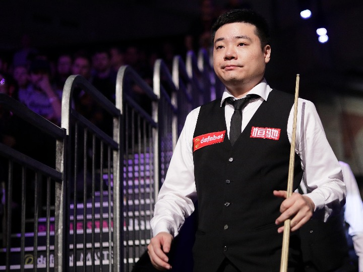 China's Ding beaten by Higgins at snooker's English Open