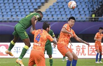 Bakambu's brace helps Beijing Guoan draw with Shandong Luneng