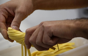 Workers make handmade pasta during World Pasta Day in Jerusalem