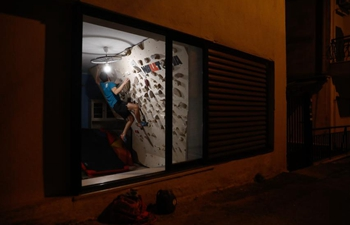 Greek rock climber resorts to home workout during second COVID-19 lockdown
